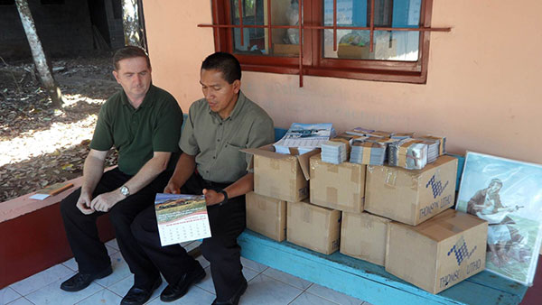 Delivering Calendars, tracts and Sunday School material to the Las Palmas church