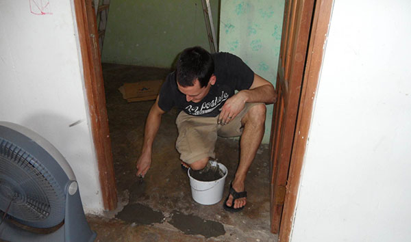Jon fixed holes in the floor and walls