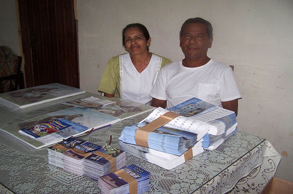Panamanian missionary, Hector Morales and his wife, receiving literature for their ministry