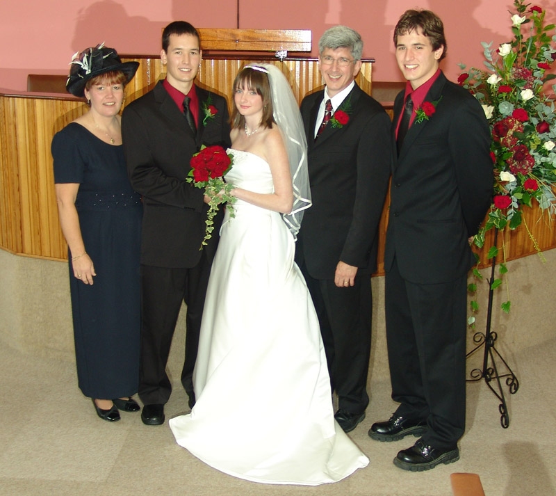 The happy couple and his parents and brother Mark.